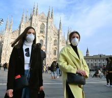 Police at checkpoints, events scrapped as virus fears hit Italy