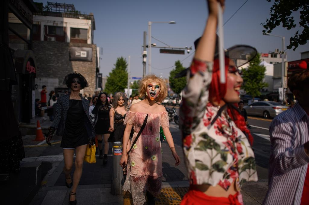 Dozens of drag queens and kings marched through Itaewon on Saturday, a suburb of Seoul best known for its nightlife and a nascent but vibrant gay scene (AFP Photo/Ed JONES)