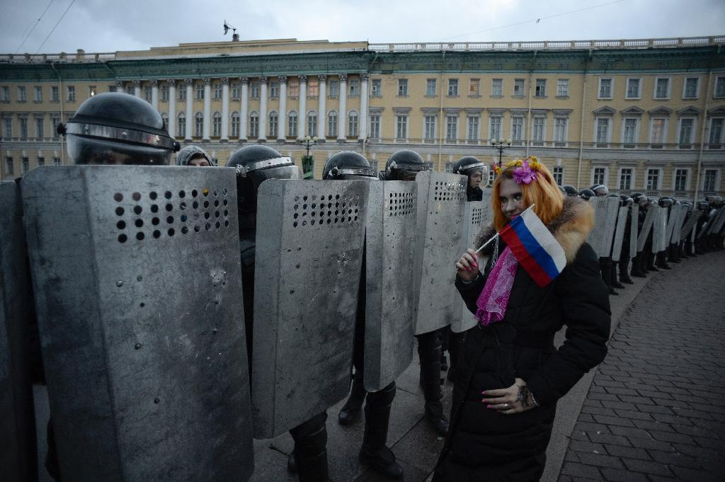 Authorities beefed up security, dispatching police vans and passenger buses to the city centre, but police largely refrained from arresting protesters (AFP Photo/OLGA MALTSEVA)