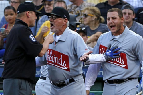 Cubs manager Joe Maddon and first baseman Anthony Rizzo argue with umpire Jeff Kellogg over a home run call that was overturned. (AP)