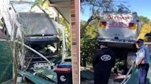 Out-of-control garbage truck smashes into Sydney family's yard