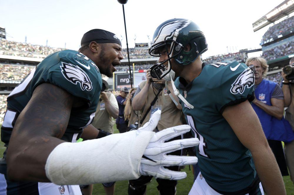 Philadelphia Eagles' Najee Goode, left, and Jake Elliott celebrate an Eagles win in September. (AP)