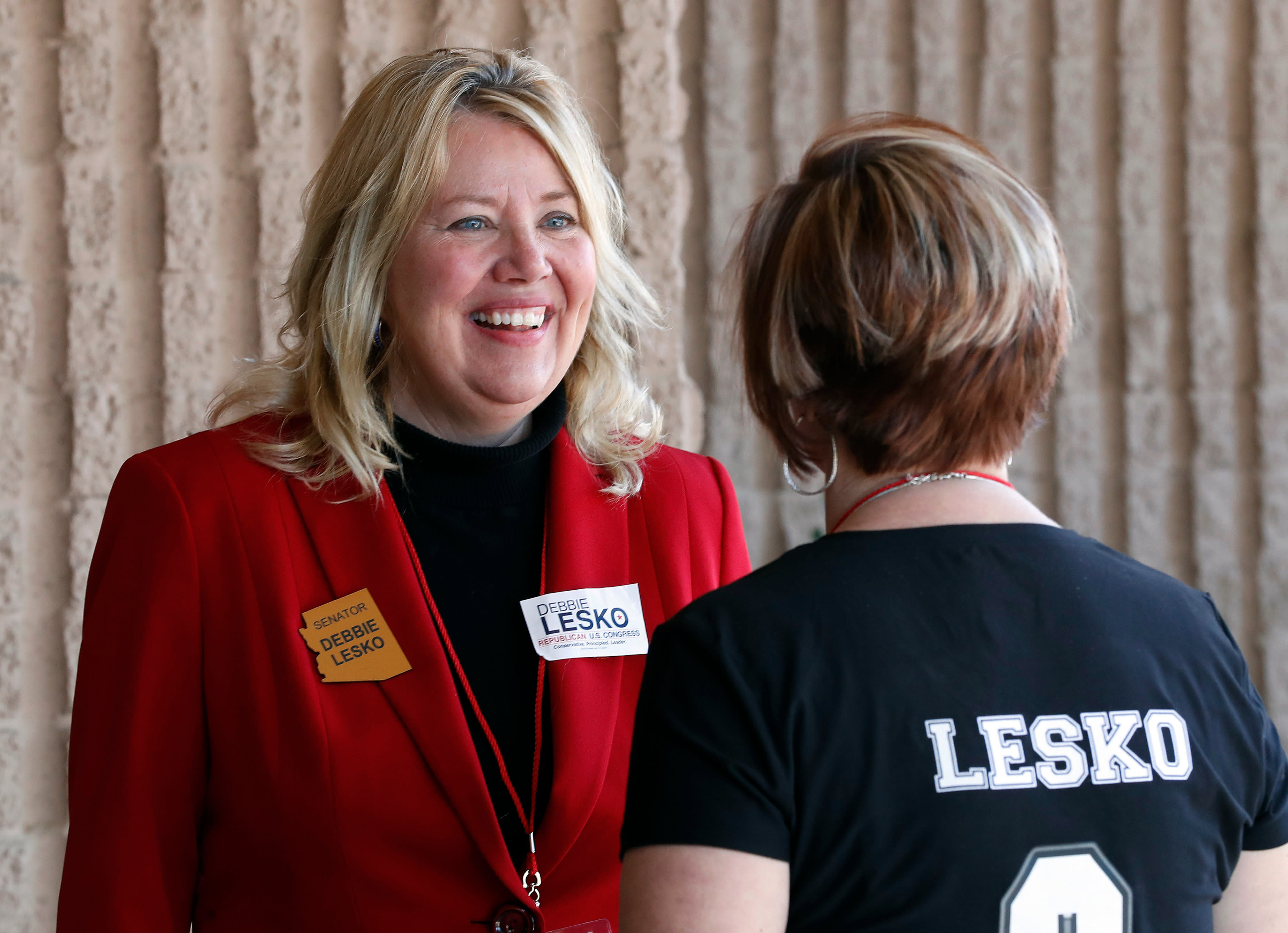 <p> FILE - In this Jan. 27, 2018, file photo, former Arizona state Sen. Debbie Lesko speaks with a constituent during the meeting of the state committee of the Arizona Republican Party in Phoenix. Lesko is running against Hiral Tipirneni in a special election, Tuesday, April 24, to fill the U.S. House seat vacated by Republican Rep. Trent Franks. (AP Photo/Matt York, File) </p>