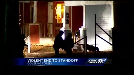 Man dies after standoff in connection with officers' slayings