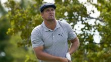 The Latest: DeChambeau, Wolff match eagles on 9th at US Open