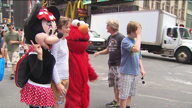 `Creepy` Times Square Characters Facing Possible Regulation