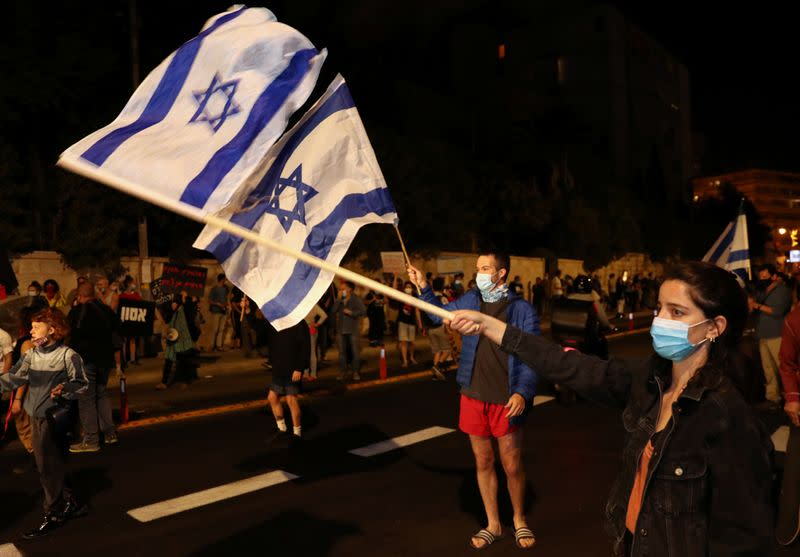 Israelis protest against law that limits protests during the coronavirus disease (COVID-19) lockdown, in Jerusalem