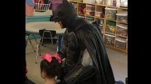 Batman walks 3-year-old to preschool after bullies gave her a black eye