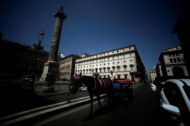 The sudden political crisis caught many in Italy off guard (AFP Photo/Filippo MONTEFORTE)