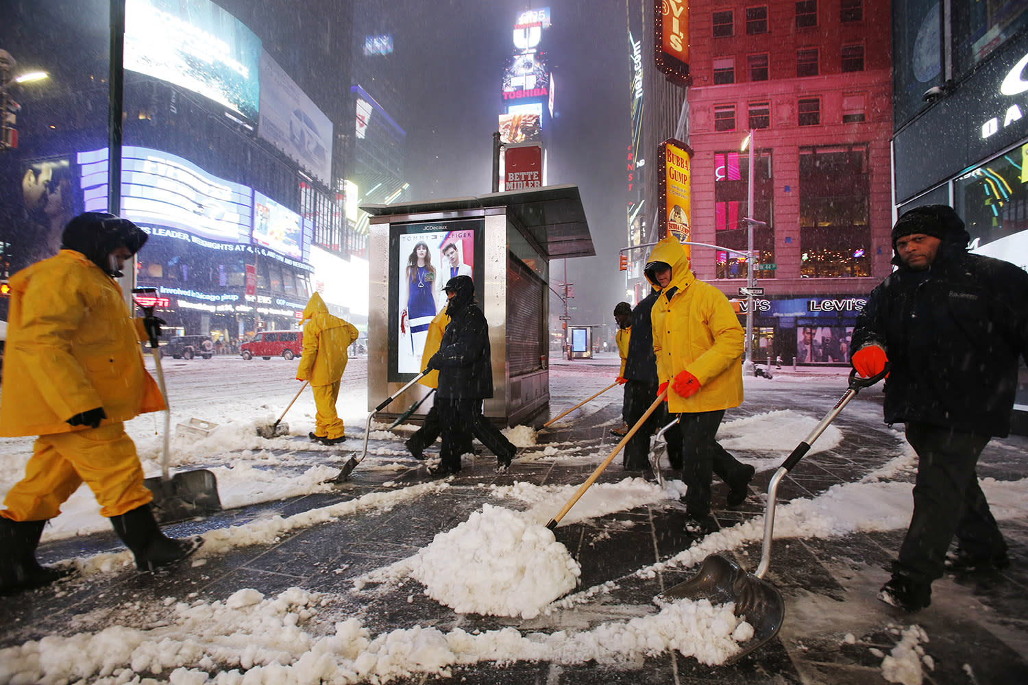 <p>A crew of snow shovelers work as a snowstorm sweeps through Times Square, Tuesday, March 14, 2017, in New York. (Mark Lennihan/AP) </p>