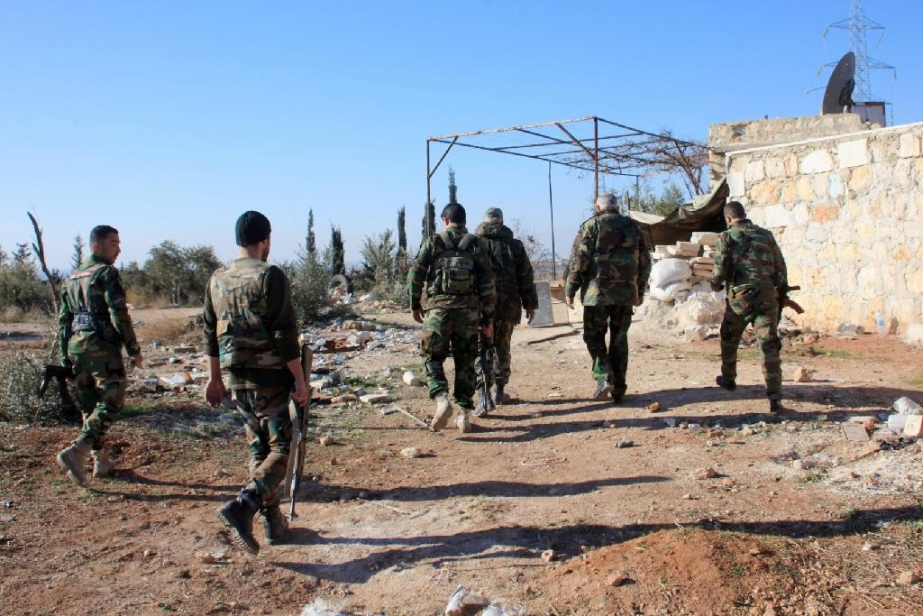 Syrian government forces patrol near Khan Tuman, south of the provincial capital Aleppo, after pro-regime forces recaptured several areas in the north from Islamist forces, including Al-Nusra Front (AFP Photo/George Ourfalian)