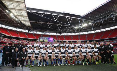 The Barbarians team pose for a photograph before the match