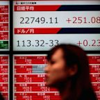 Asia markets nudge higher; bitcoin futures make their big debut