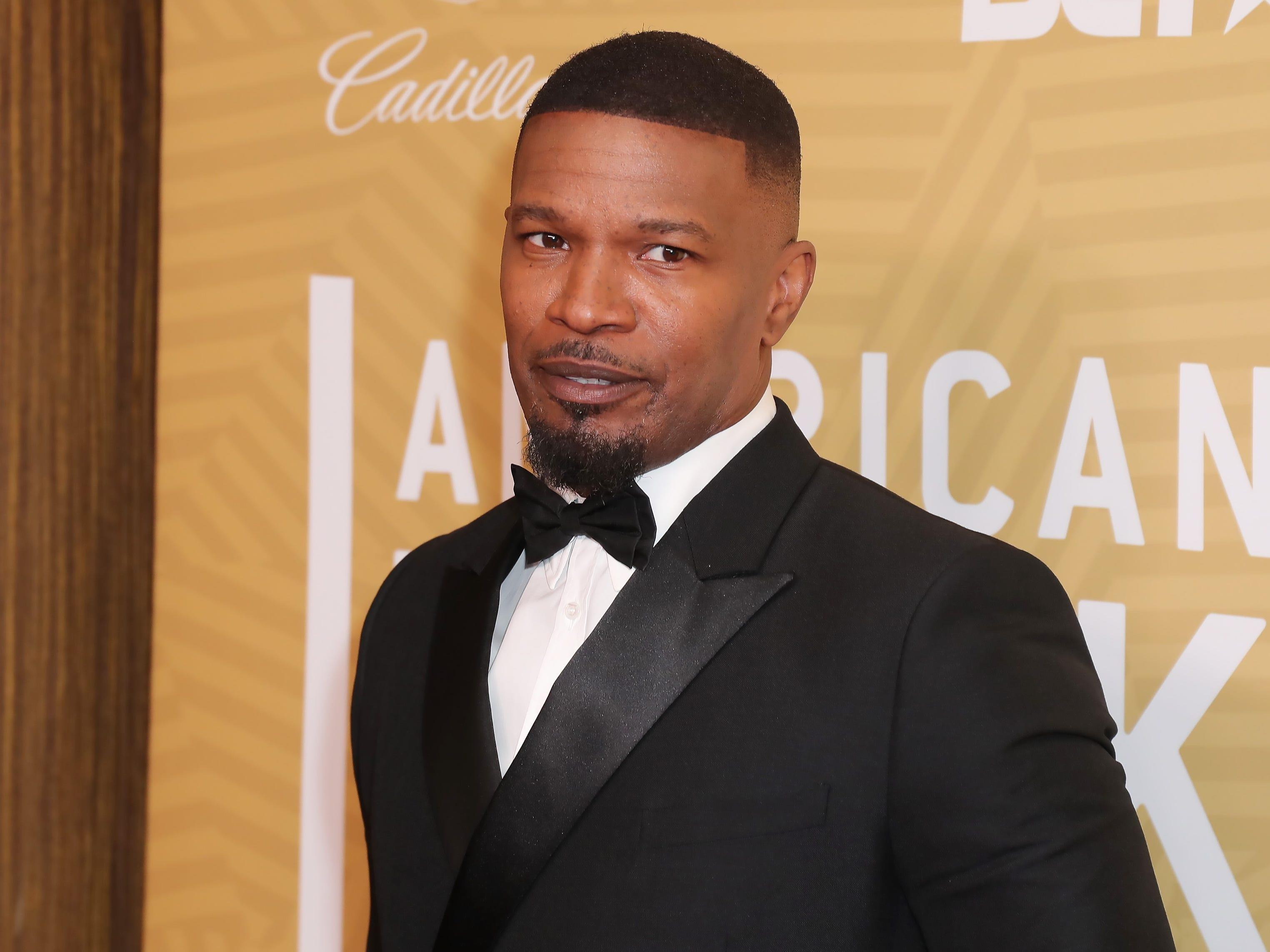 Jamie Foxx doesn't have a personal trainer or lift weights - he swears by doing pull-ups to stay fit and toned