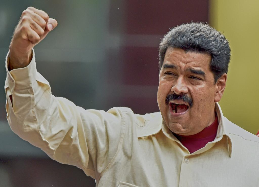 Venezuelan President Nicolas Maduro gestures during a rally in Caracas on April 19, 2016 (AFP Photo/Juan Barreto)
