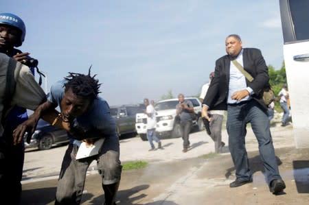 Haiti legislator fires handgun at protest, photojournalist injured