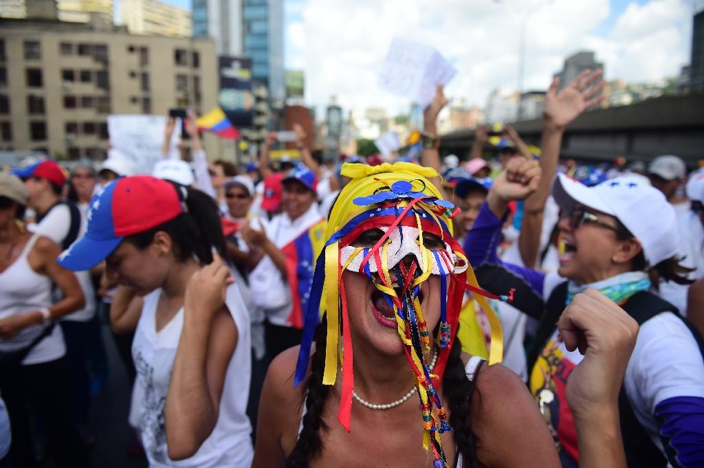 A march in Caracas by thousands of women dressed in white was the latest in more than a month of anti-government demonstrations (AFP Photo/RONALDO SCHEMIDT)