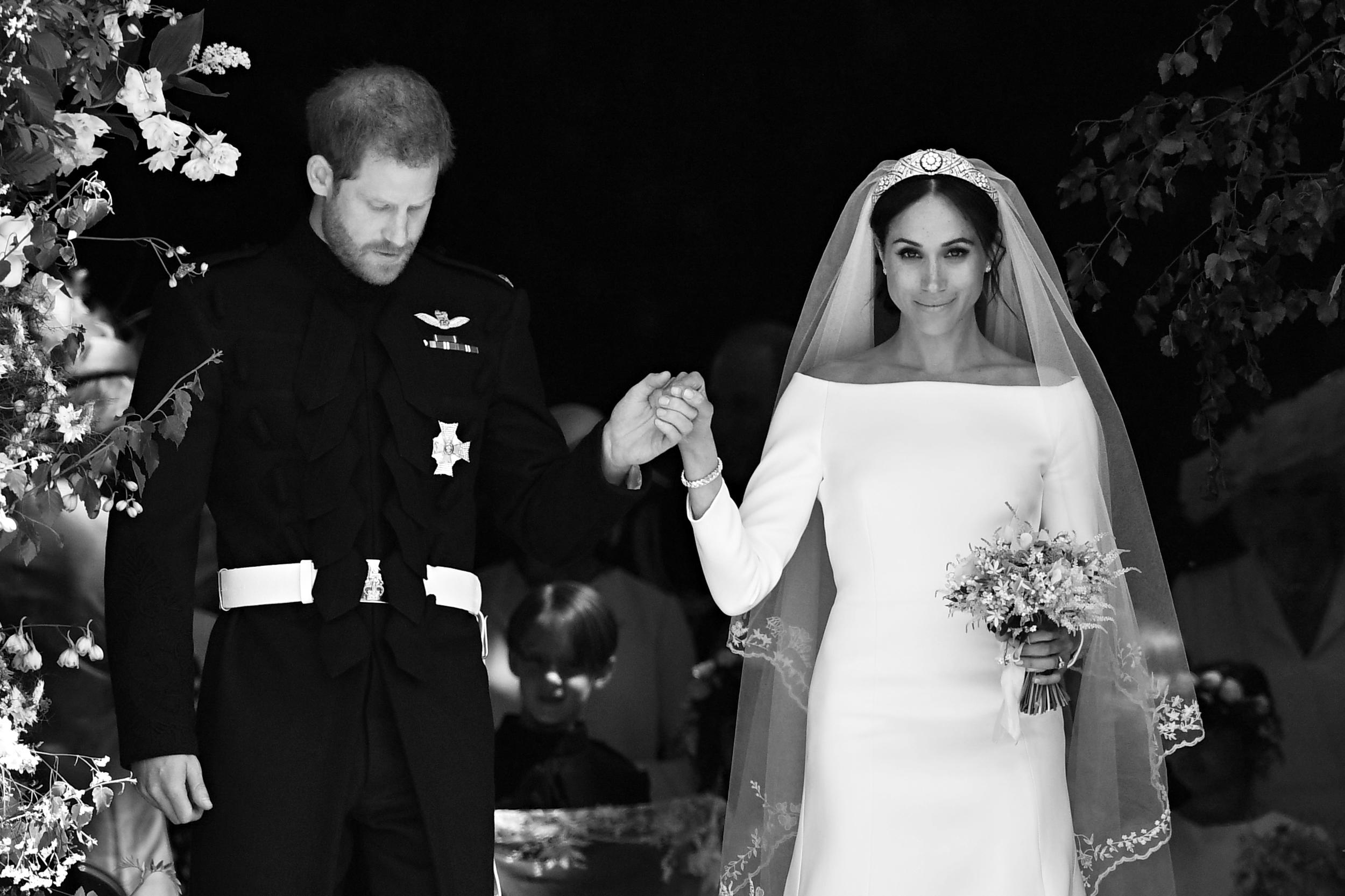 <p>Britain's Prince Harry, Duke of Sussex and his wife Meghan, Duchess of Sussex emerge from the West Door of St George's Chapel, Windsor Castle, in Windsor, on May 19, 2018 after their wedding ceremony.</p>  <p>(Photo by Ben STANSALL / POOL / AFP)</p>