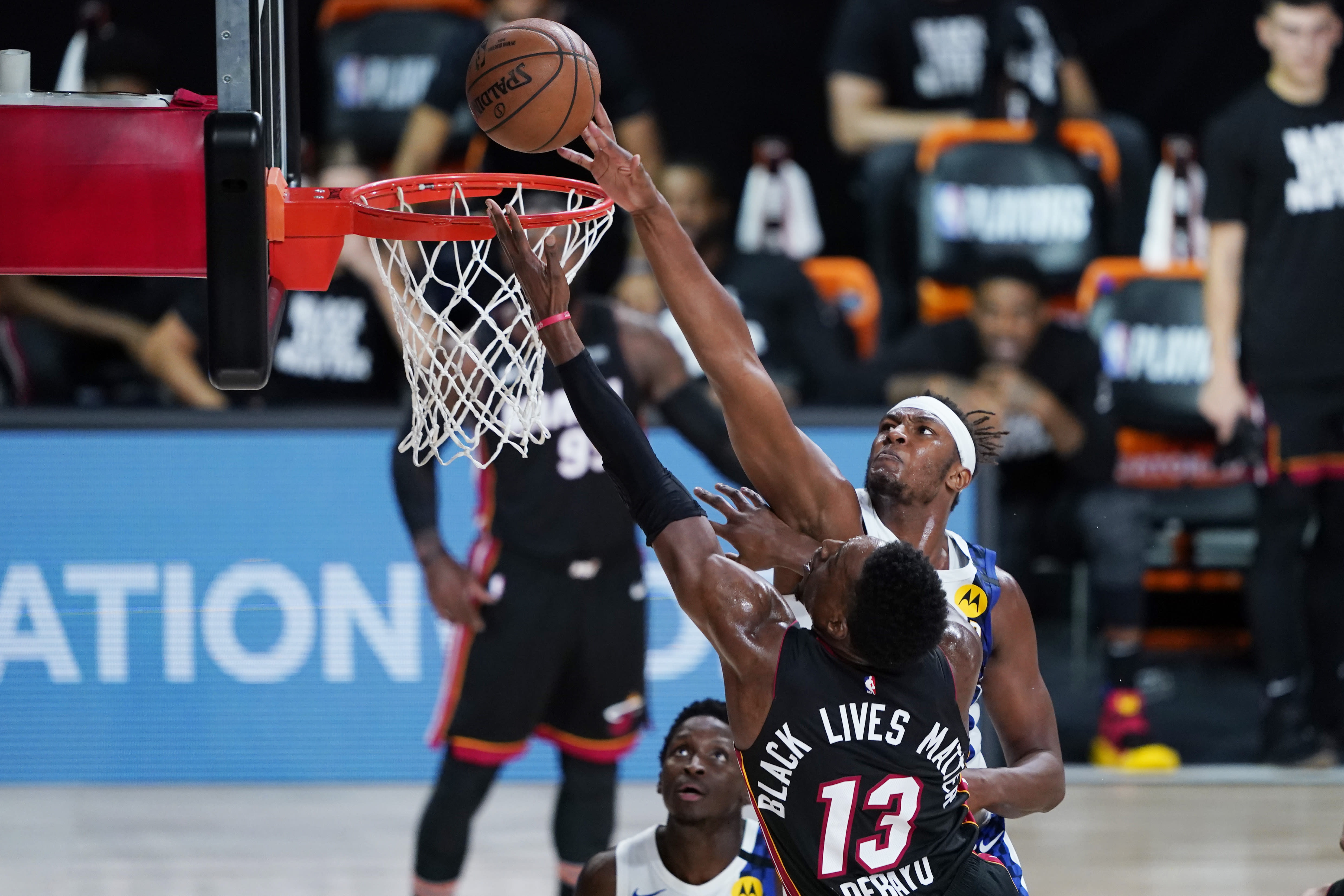 Indiana Pacers center Myles Turner (33) blocks a shot by Miami Heat forward Bam Adebayo (13) during the second half of an NBA basketball first round playoff game, Saturday, Aug. 22, 2020, in Lake Buena Vista, Fla. (AP Photo/Ashley Landis, Pool)