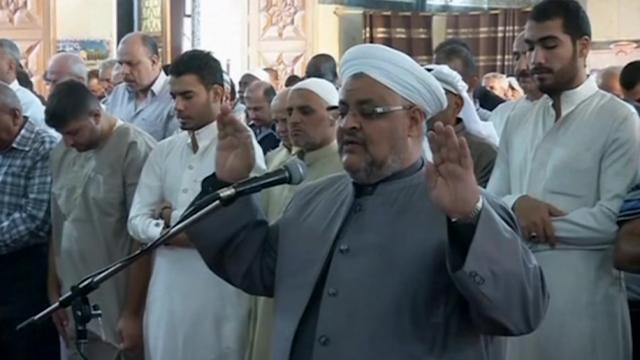 Iraqis pray for peace on first day of Eid