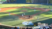 College baseball player soars over catcher to score a breathtaking run