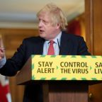 Johnson eases lockdown as furore over aide rumbles on