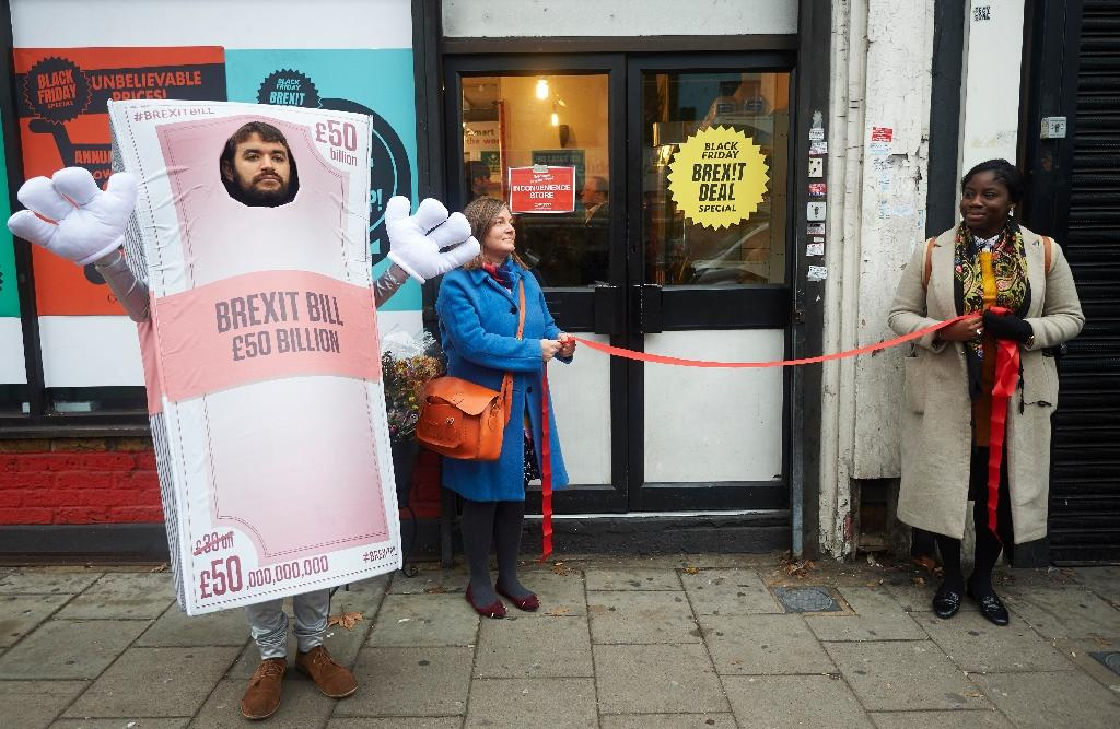 Activists perform a mock opening of a post-Brexit inspired pop-up shop in south London offering products 'which represent the miserable Brexit on offer' (AFP Photo/Niklas HALLE'N)