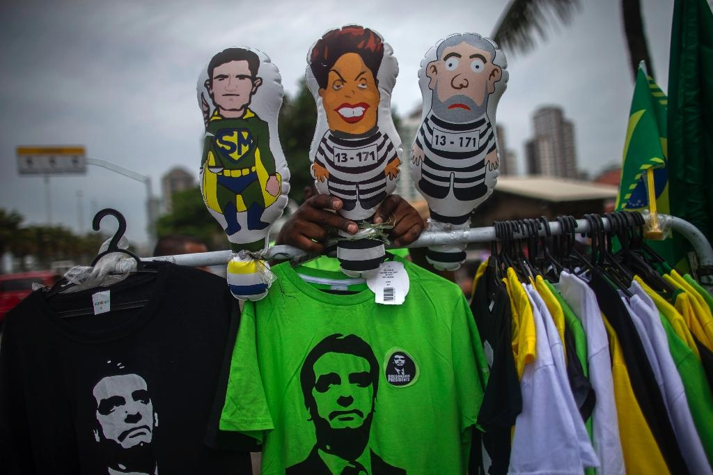 Brazilian president-elect Jair Bolsonaro, emblazoned on t-shirts pictured in Rio on November 1, 2018, has doubled down on his vow to roll back gun-control laws (AFP Photo/Mauro Pimentel)