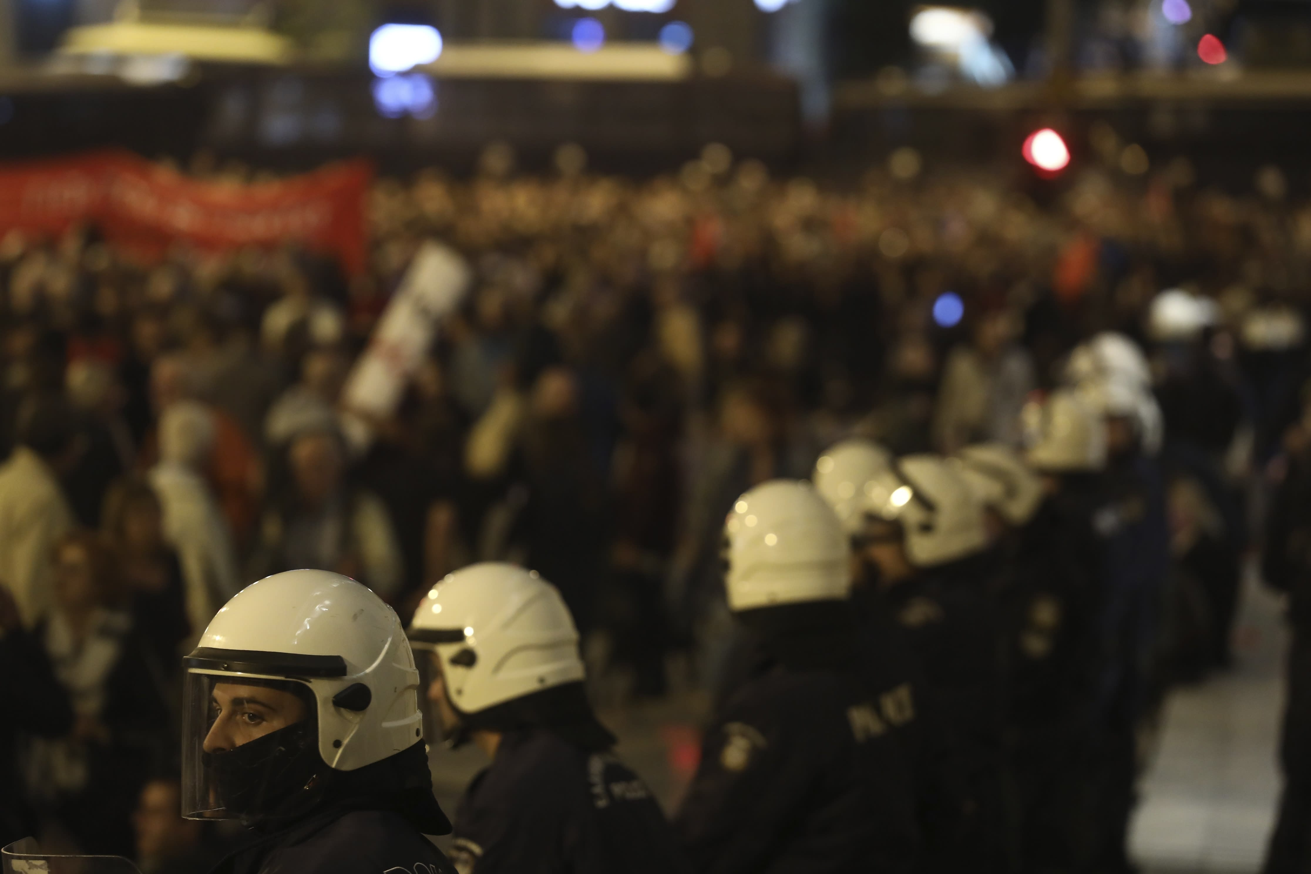 Riot police guard at Syntagma square during a rally in Athens, Sunday, Nov. 17, 2019. Several thousands people march to the U.S. Embassy in Athens under tight police security to commemorate a 1973 student uprising that was crushed by Greece's military junta, that ruled the country from 1967-74. (AP Photo/Yorgos Karahalis)