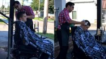Barber sets up shop outside to give customer in a wheelchair a haircut
