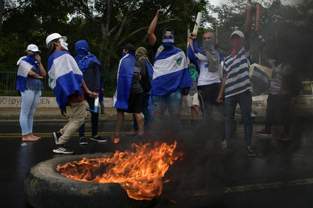 "The Nicaraguan minister for finance and public credit blames the reduction on protesters accused of trying to stage a ""coup"" against President Ortega's government"