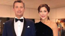 Princess Mary holds hands with Prince Frederik at Buckingham Palace party