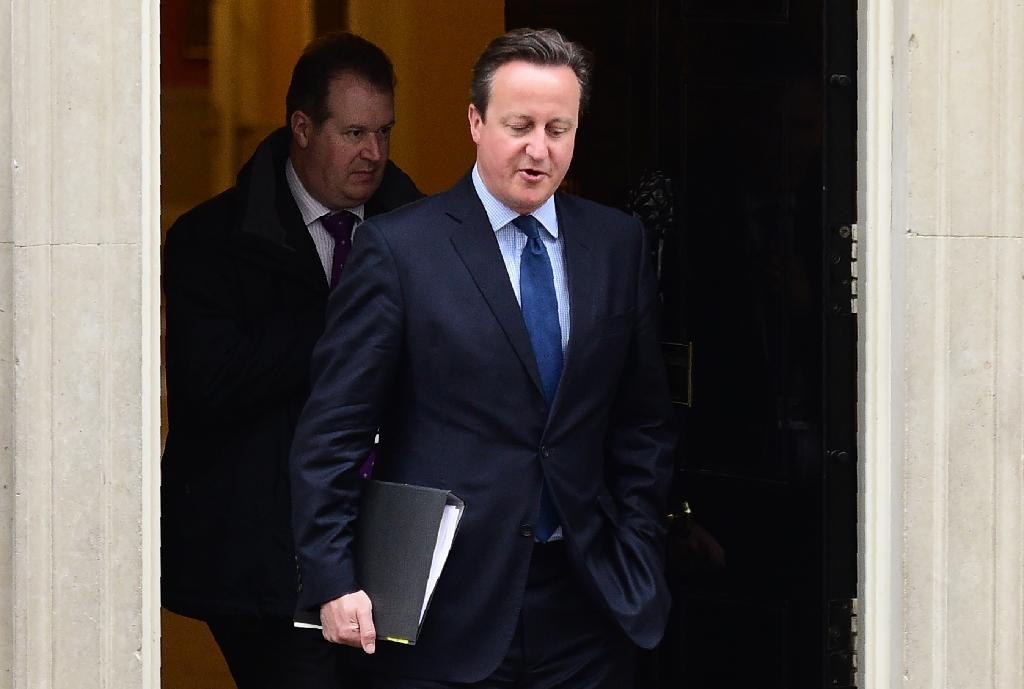 British Prime Minister David Cameron leaves Downing street to make a statement at the Houses of Parliament on April 11, 2016 in London