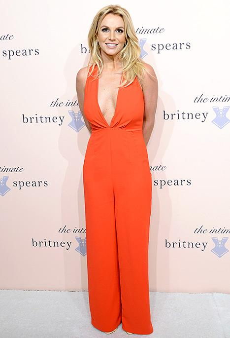 Britney Spears Looks Red Hot In Plunging Jumpsuit To Debut New