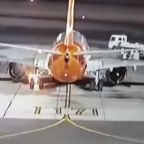 Plane's landing gear bursts into flames after touching down at airport