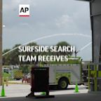 Surfside search team receives heroes welcome