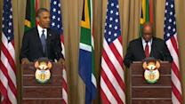 Obama praises Mandela's courage in S. Africa