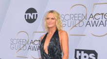 Robin Wright, 52, stuns in revealing gown with plunging neckline and thigh-high slit at SAG Awards