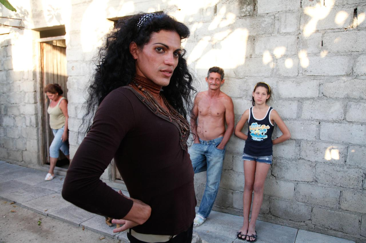 <p>Malu with her parents and sister in front of their home in Cienfuegos. <i>(Photo: Mariette Pathy Allen)</i></p>