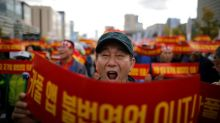 Thousands of Seoul taxi-drivers rally against plans for carpool service