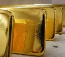 Gold gains as surging virus cases eclipse positive U.S. data