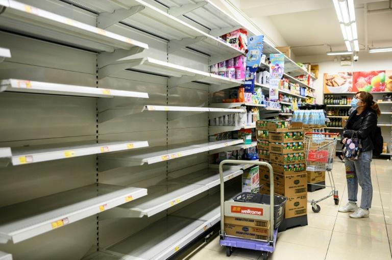 Photos of empty supermarket shelves prompted the government to condemn those spreading rumours that the city was running out of toilet paper (AFP Photo/Philip FONG)