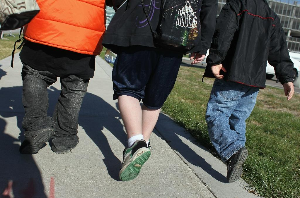Children with severe obesity -- which affects 4.5 million children in the United States -- face only a one in five chance of being normal weight adults (AFP Photo/JOHN MOORE)