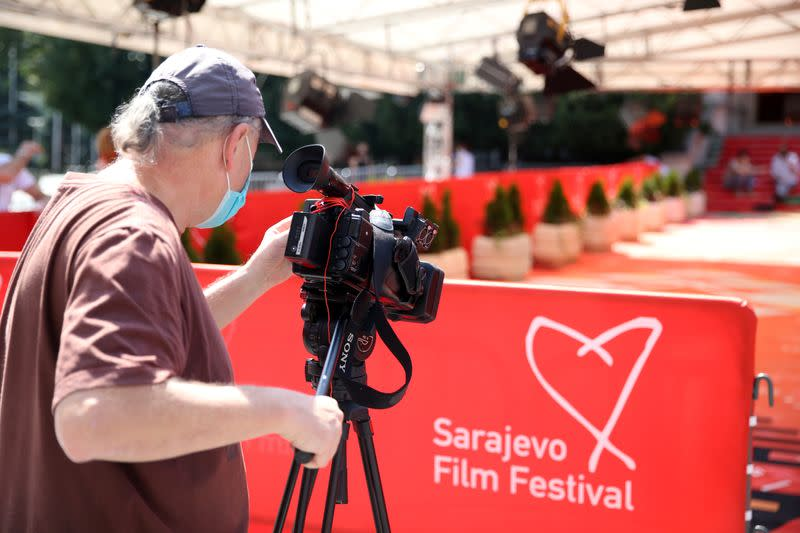 Cameraman records a red carpet before the online opening ceremony of the Sarajevo Film Festival in Sarajevo