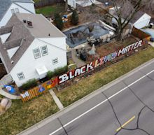 Black Lives Matter fence in Minnesota at center of row in city on edge
