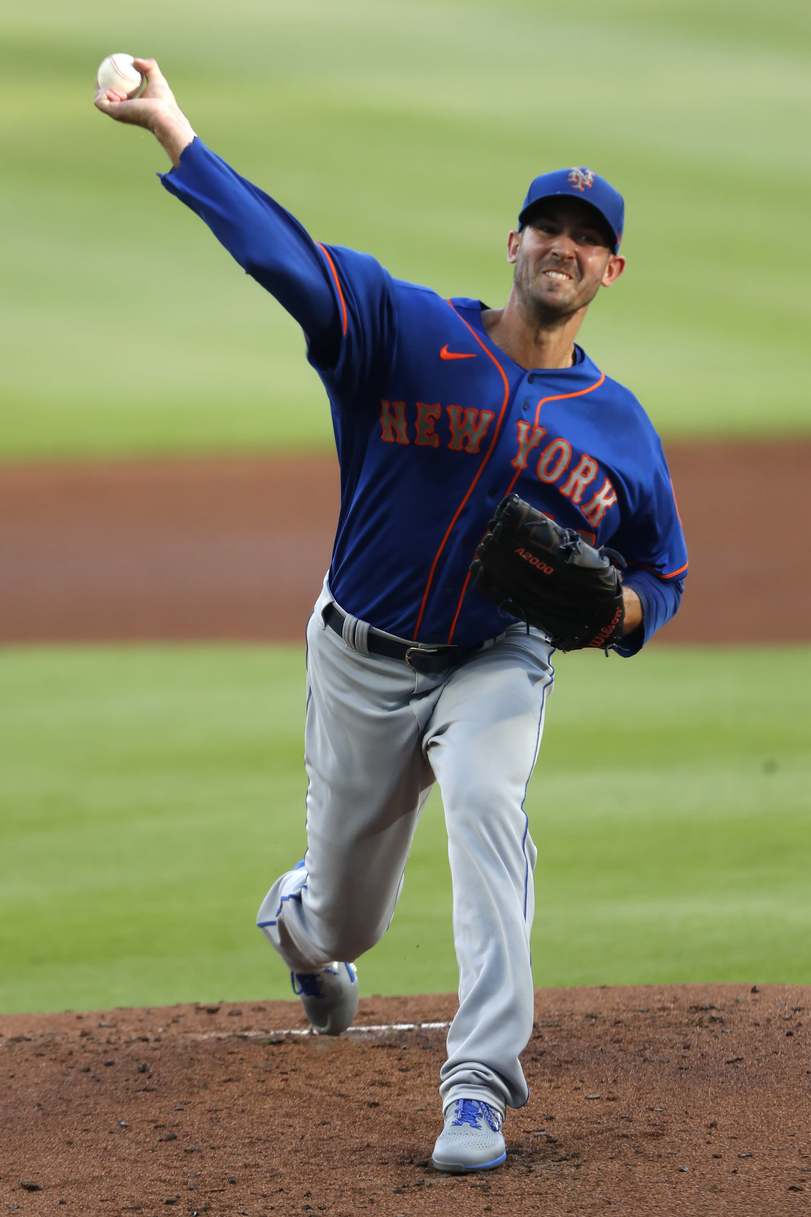 New York Mets starting pitcher Rick Porcello delivers in the first inning of a baseball game against the Atlanta Braves, Friday, July 31, 2020, in Atlanta. (AP Photo/John Bazemore)