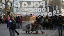 Argentine markets hold steady as anti-Macri protesters decry austerity, rising poverty
