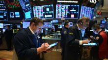 US STOCKS-Tesla lifts Nasdaq to record-high close, S&P 500 dips