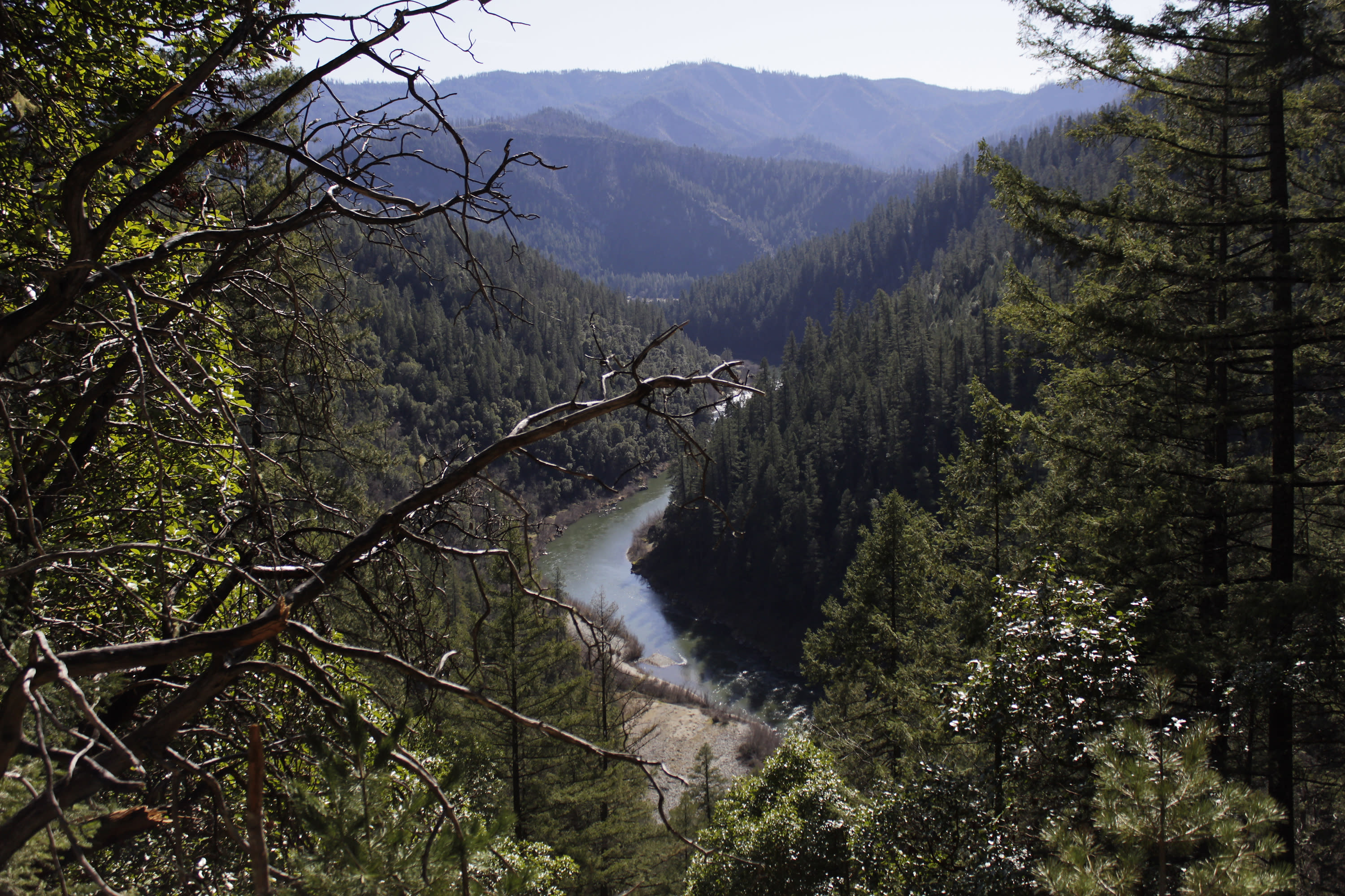 FILE - In this March 3, 2020, file photo, the Klamath River is seen flowing across northern California from atop Cade Mountain in the Klamath National Forest. Federal regulators on Thursday, July 16, 2020, threw a significant curveball at a coalition that has been planning for years to demolish four massive hydroelectric dams on a river along the Oregon-California border to save salmon. (AP Photo/Gillian Flaccus, File)