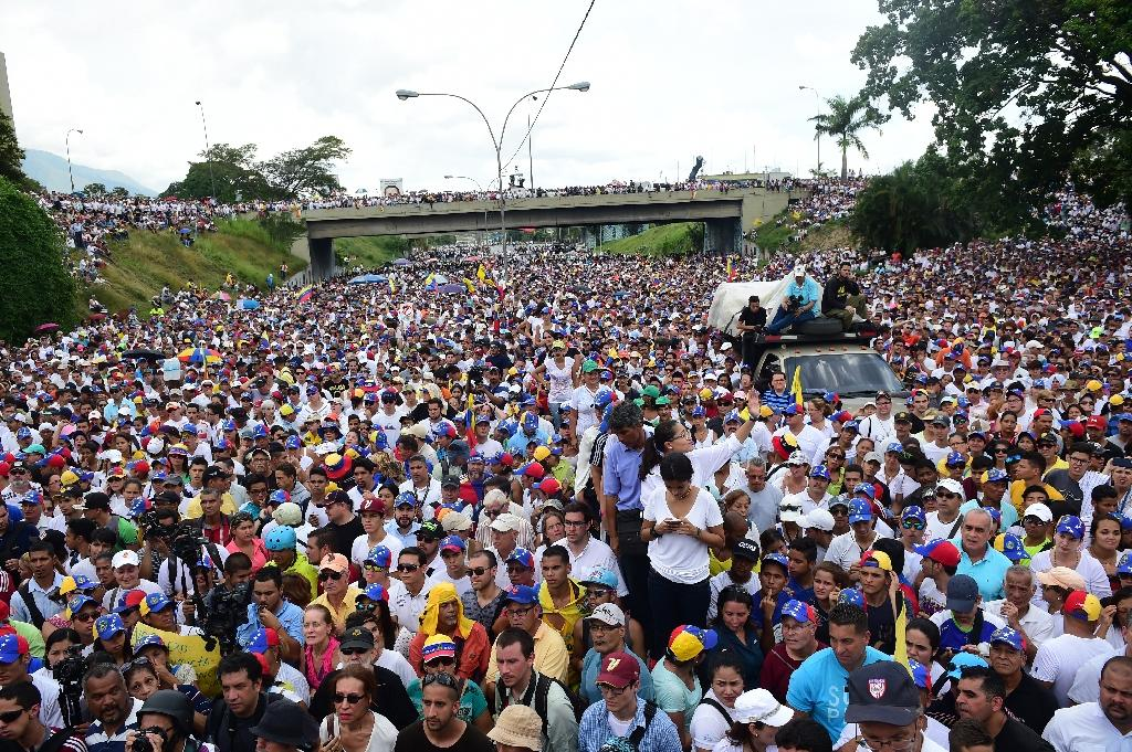 People demonstrate against the government of Venezuelan President Nicolas Maduro in Caracas on October 26, 2016